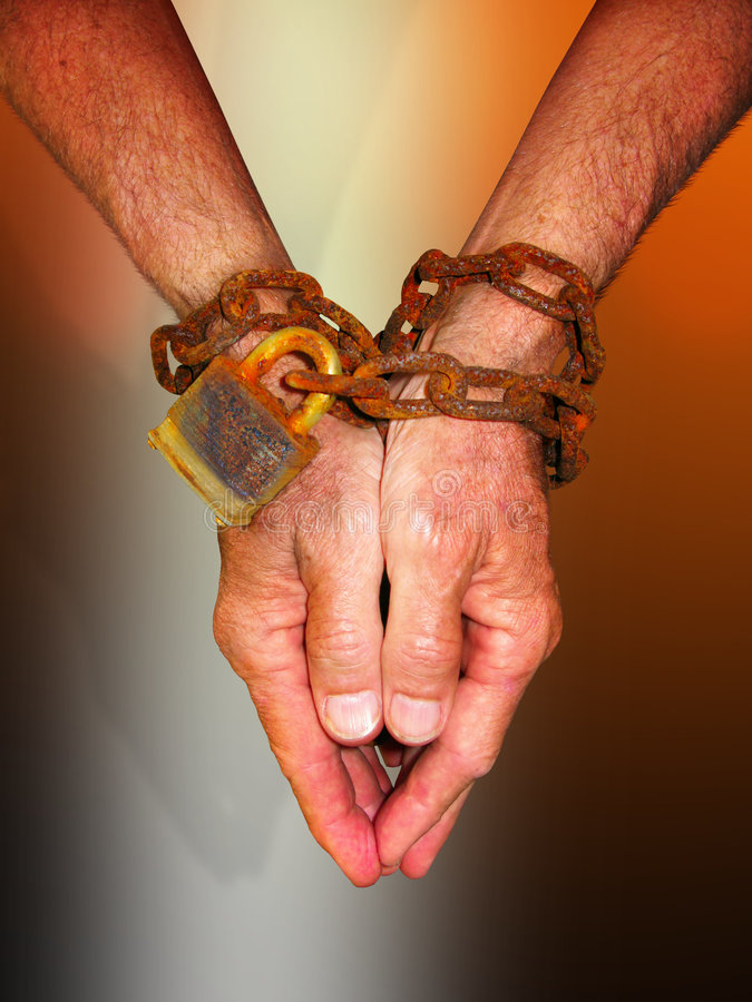 Hands in chains stock image