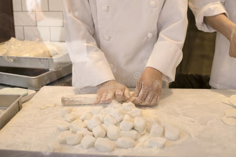 Hands of chefs making dough for grilled rice dumplings in Chinatown in Kobe in Japan. Food royalty free stock photos