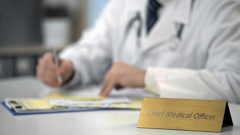 Hands of chief medical officer ordering medicines online, typing on laptop stock photography