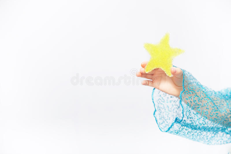 Hands of a child holding small star stock photography