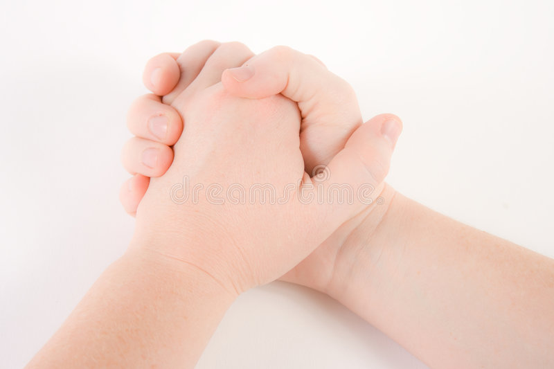 Hands clasped stock images