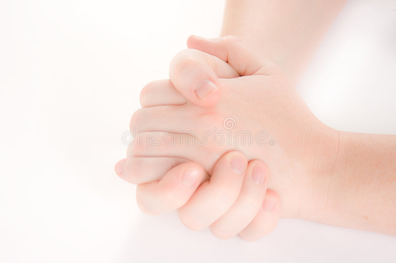 Hands clasped royalty free stock photo