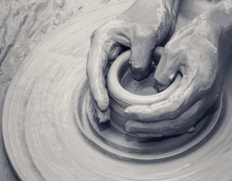Hands in clay at process of making ceramic on pottery wheel stock photo