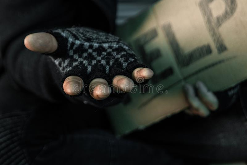 Hands close up poor old man or beggar begging you for help sitting at dirty slum. Concept for poverty or hunger people,human royalty free stock photos