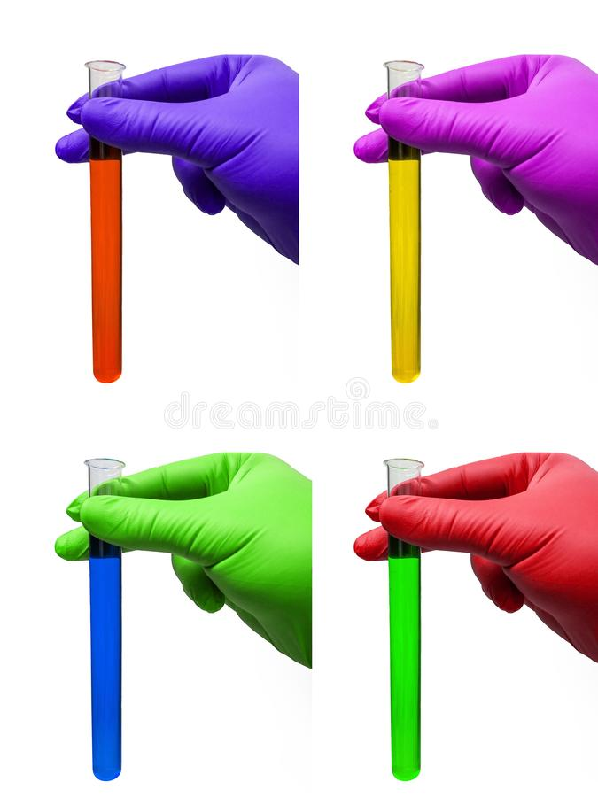 Hands with rubber gloves and test tubes with colored fluids - colorful. Hands with colored rubber gloves and test tubes with colored fluids royalty free stock image