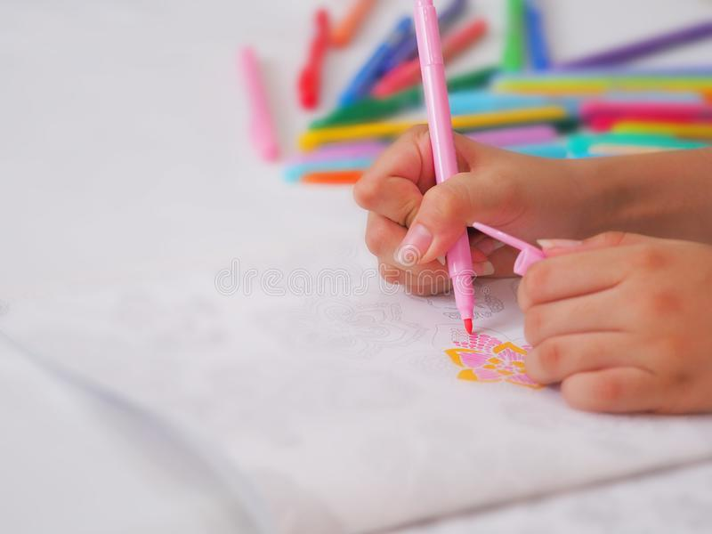 Hands colouring/coloring on peper with variety colour pen background stock images