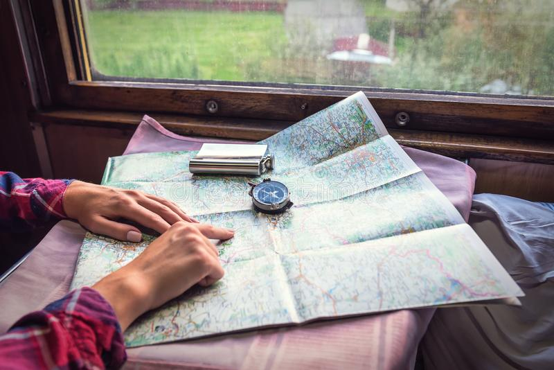 Hands, compass and map stock photo