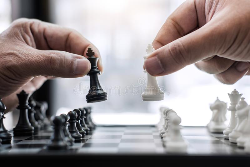 Hands of confident businessman colleagues playing chess game to. Development analysis new strategy plan, leader and teamwork concept for win and success royalty free stock photos