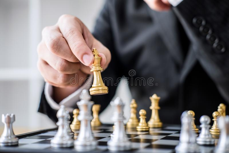 Hands of confident businessman playing chess game to development analysis new strategy plan, leader and teamwork concept for win. And success royalty free stock photo