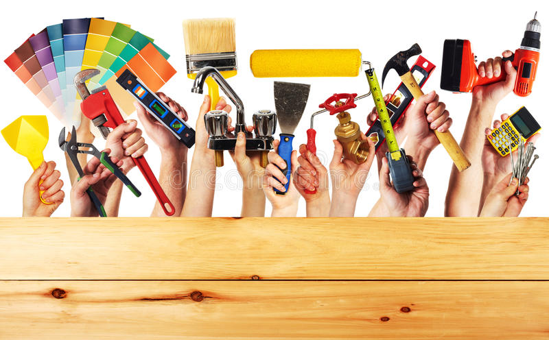 Hands with construction tools. royalty free stock photos