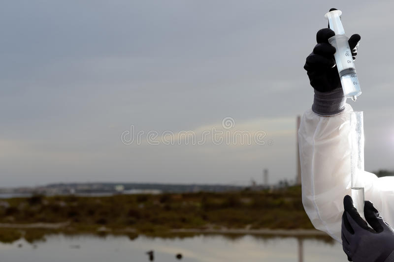 Hands control polluted water. stock photos