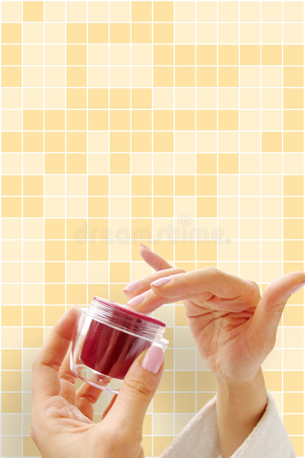 Hands with a cosmetic cream royalty free stock images