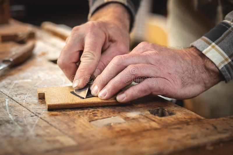 Detail of the hands of an artisan stock photography