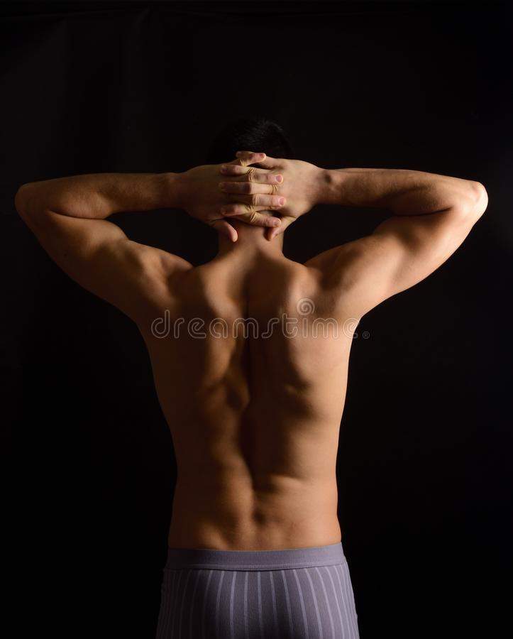 Hands crossed on the nape of the neck, photo on the back royalty free stock photography