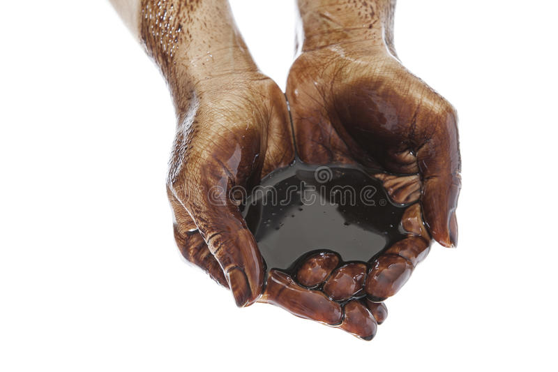 Hands cupped with black oil. Caucasian hands cupped with black petrol isolated on white background stock photo
