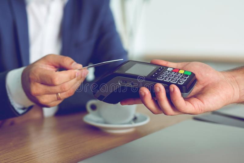 Hands of customer paying restaurant bill using credit card royalty free stock photos