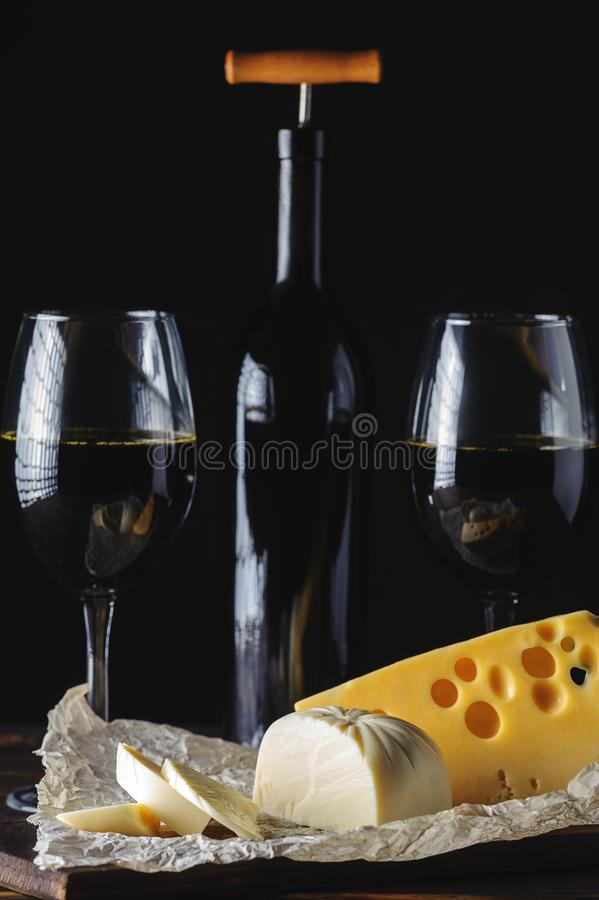 Hands cut the cheese to wine stock photos
