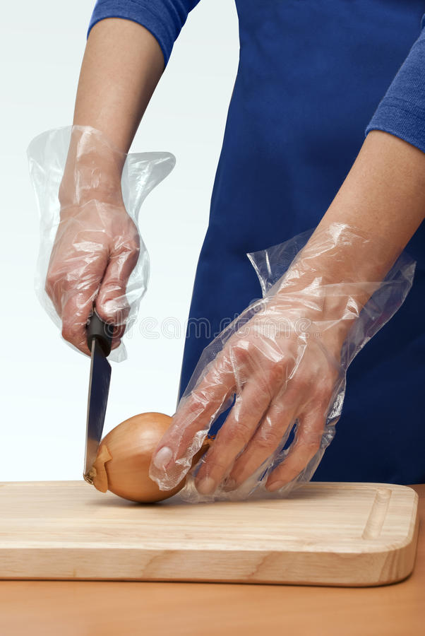 Hands cut the onion royalty free stock image