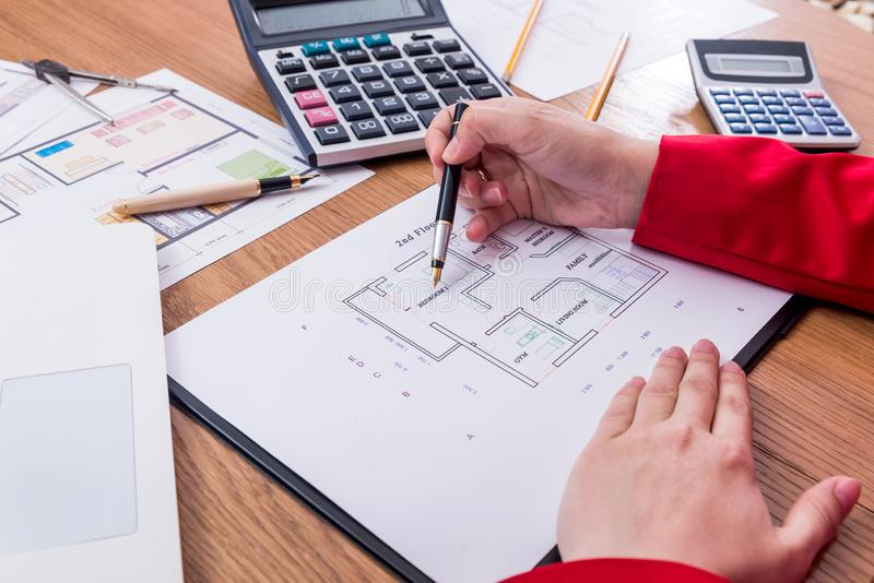 Hands of designer and house plan, new project development stock photography
