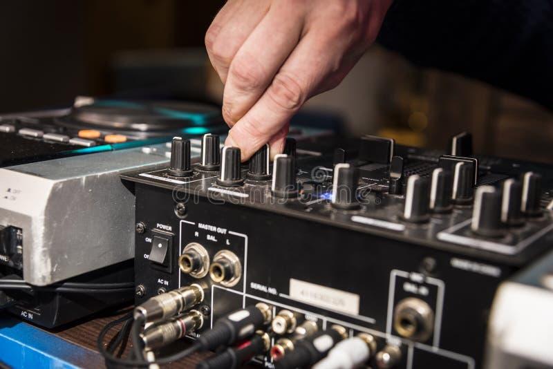 DJ`s hands at work stock photo