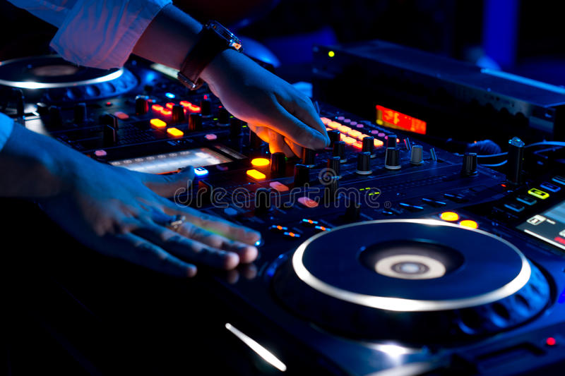 Hands Of A Dj Mixing Music At A Disco Stock Photo Image