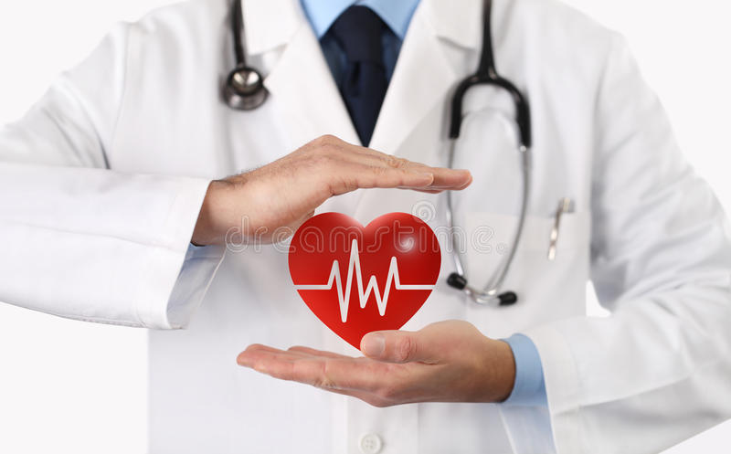 Hands doctor protect heart symbol. With his hands royalty free stock photography