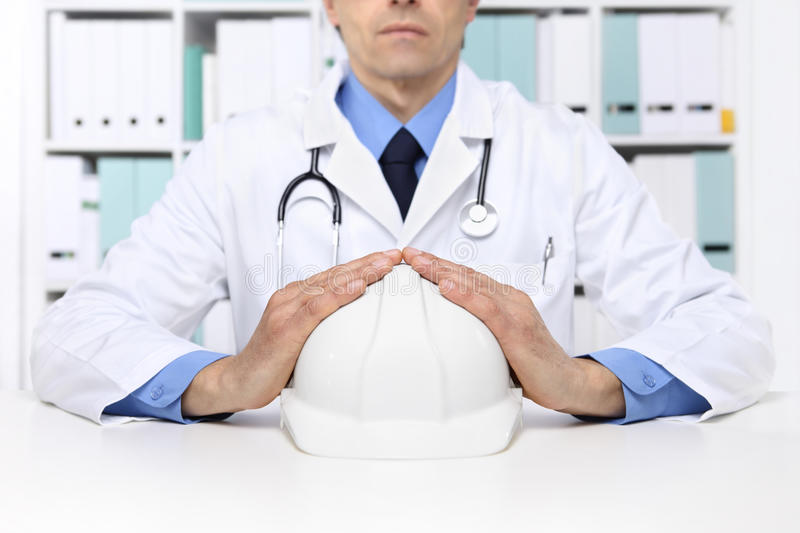 Hands doctor protect helmet worker, medical health insurance con royalty free stock image