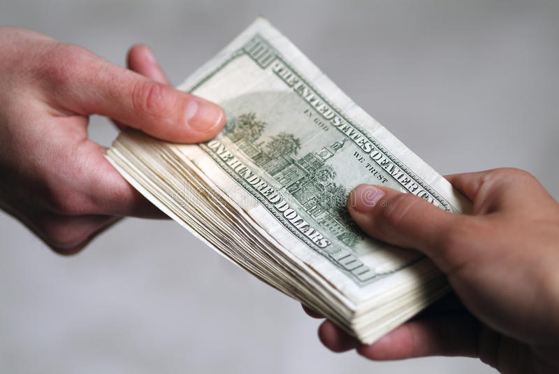 Hands with dollars. royalty free stock photography
