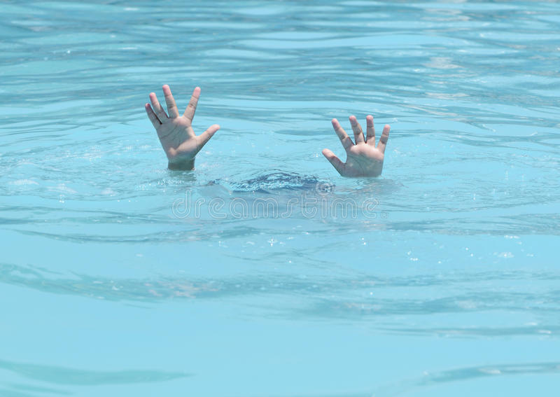 Hands of drowning boy stock image