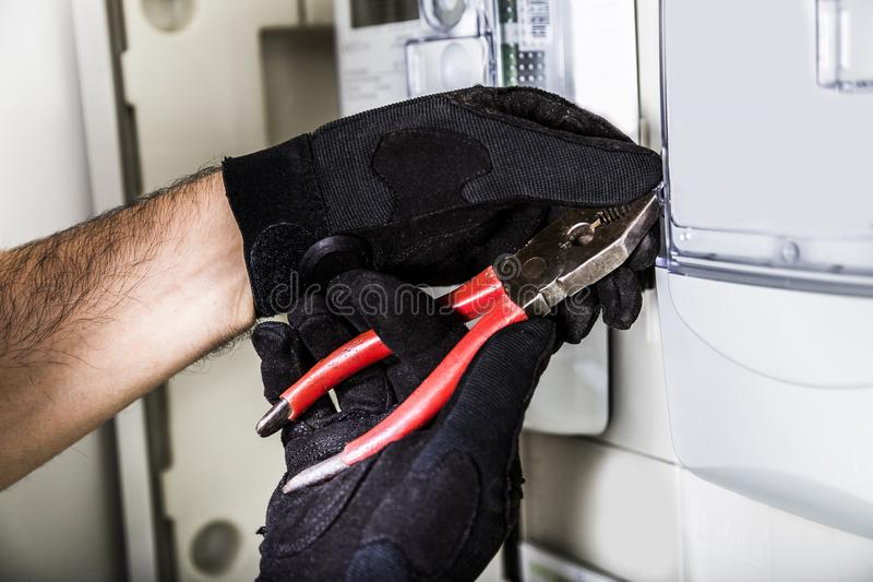 Electrician connecting wires in distribution board close up royalty free stock photo