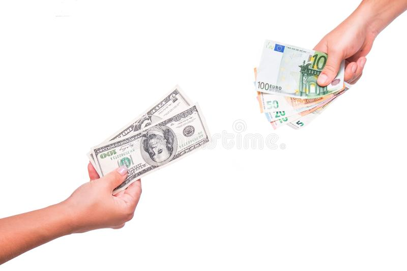 Hands exchange dollars for euros. People exchange currency, hands transmit money. Hand holds dollar and euro banknotes. royalty free stock image