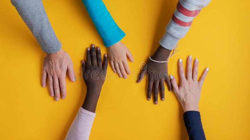 Hands of family of five stock photo