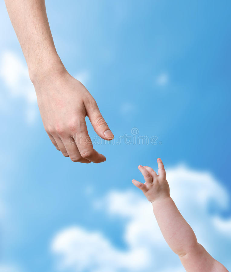 Hands of father and baby stretching to each other royalty free stock photography