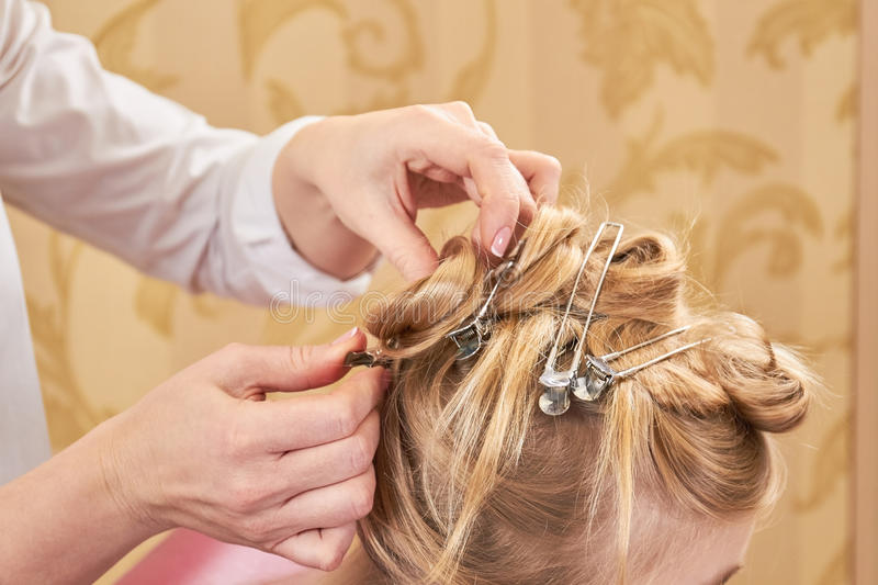 Hands of female hairstylist working. stock photos