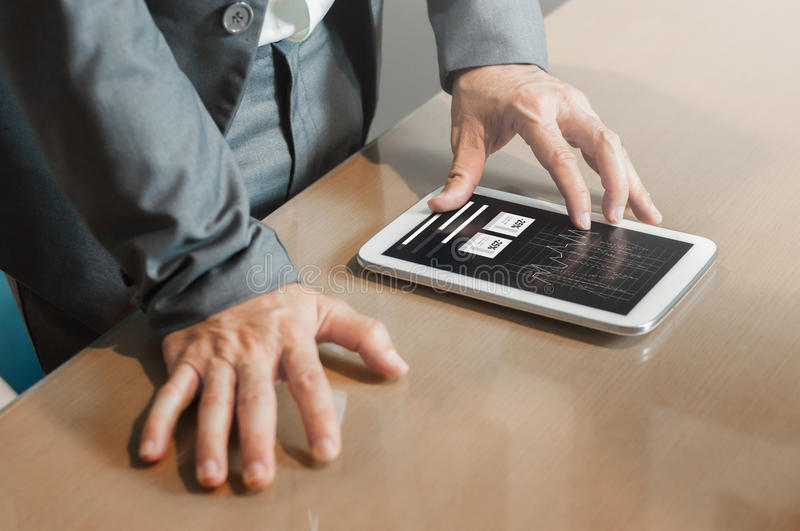 Hands of financial manager on tablet. Businessman planning strategy his work. stock image