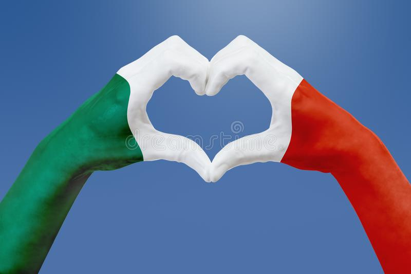 Hands flag of Mexico, shape a heart. Concept of country symbol, on blue sky. royalty free stock photography