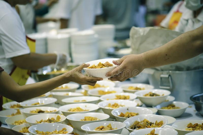 Hands-on food of the hungry is the hope of poverty : concept of homelessness.  stock image
