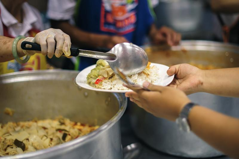 Hands-on food of the hungry is the hope of poverty : concept of homelessness.  royalty free stock photo