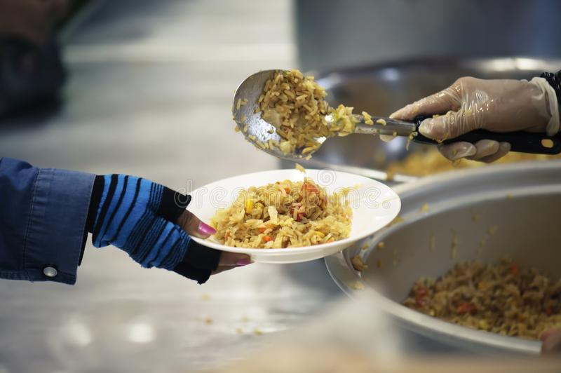 Hands-on food of the hungry is the hope of poverty : concept of homelessness.  stock photography