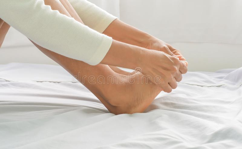 Foot massage in old women stock photo