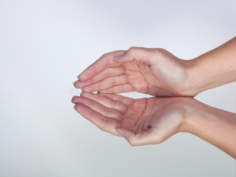 2 Hands Forming a Bowl shape stock photos