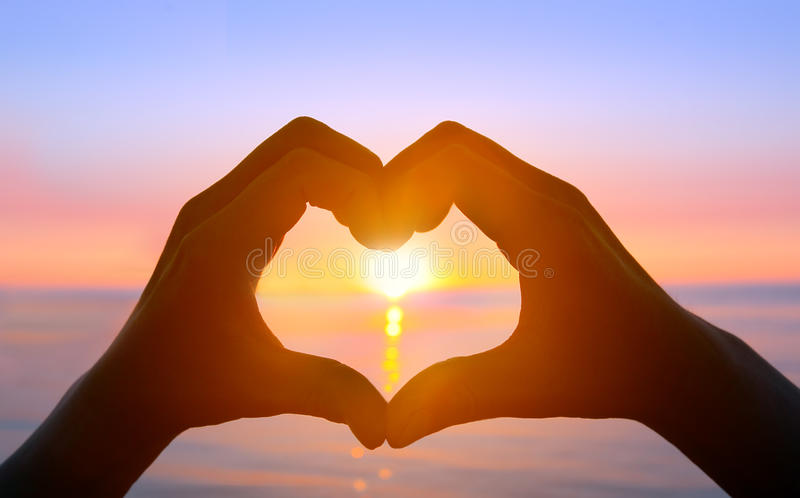 Hands forming a heart royalty free stock photo