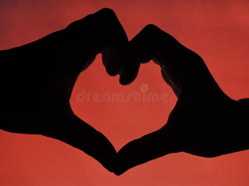 Hands forming a heart shape stock photo
