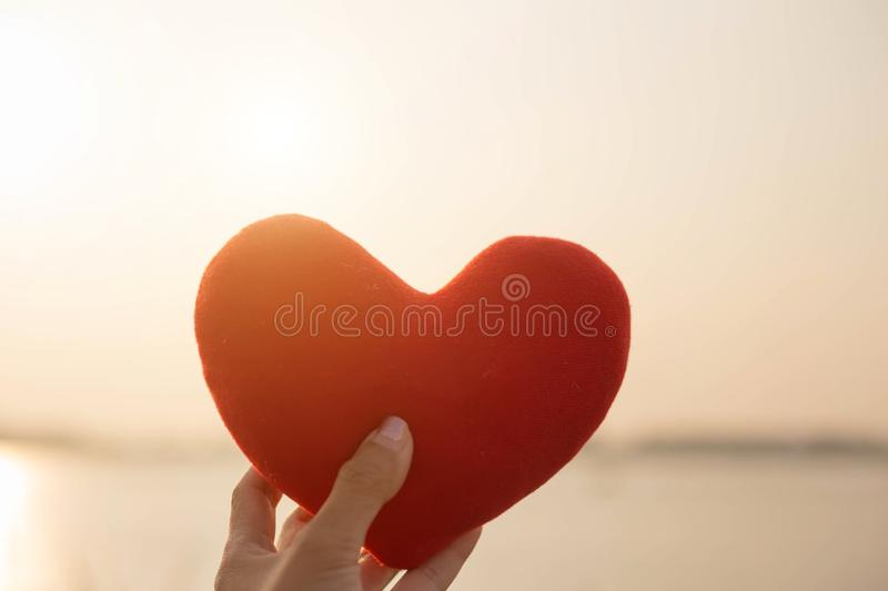 Hands forming a heart shape with sunset silhouette royalty free stock image