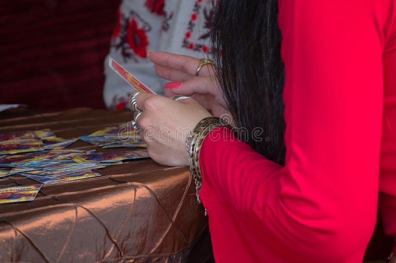 Hands of the fortuneteller who is telling fortune. Mysticism stock images
