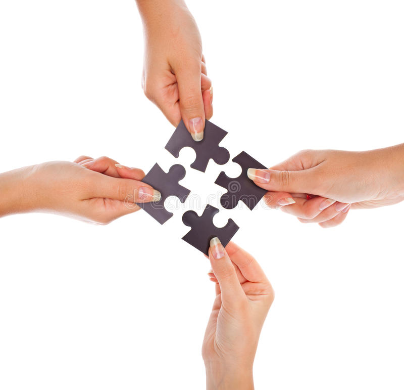 Download Hands with four puzzles stock image. Image of jigsaw - 11133011