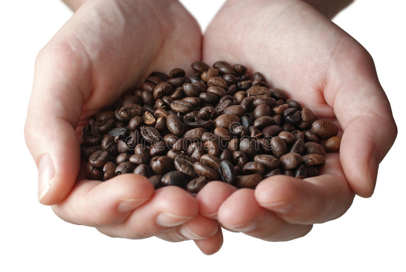 Hands full of coffee stock image