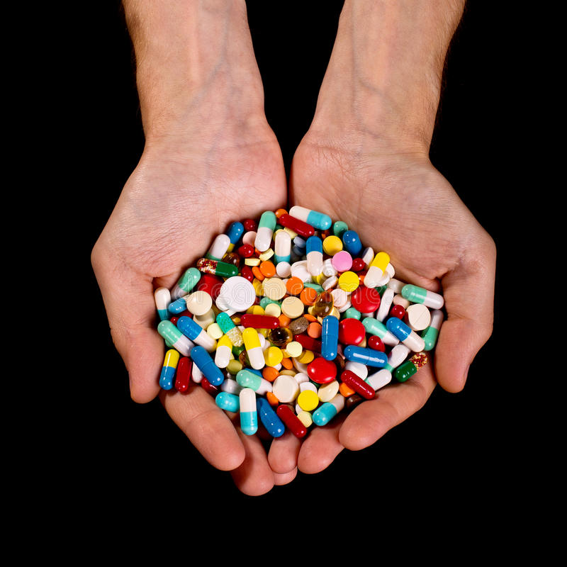 Free Hands Full Of Pills Royalty Free Stock Photo - 26560095