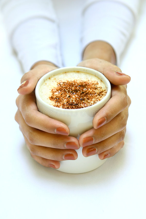 Hands Gently Warming Against A Cup Of Coffee Stock Image