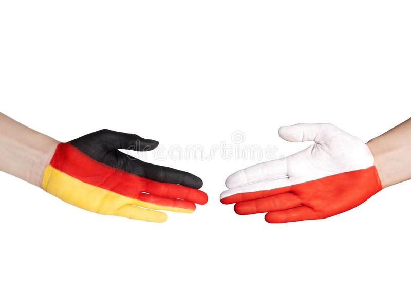 Hands with german and polish flag. Two hands with german and polish flag doing a handshake stock photos